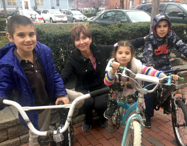 kids on bikes with mom