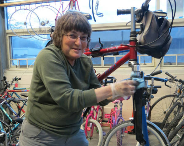 Women working on a bike at women's class