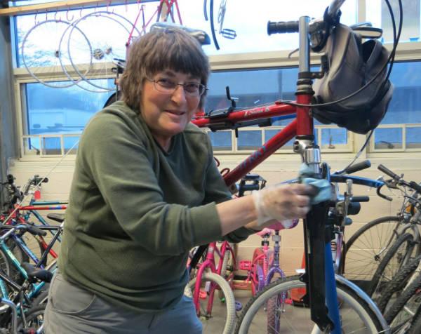 Women working on a bike at women's class