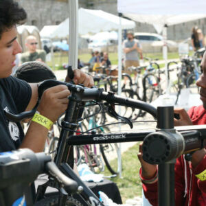 Local kids working on bikes at Newport Folk Fest