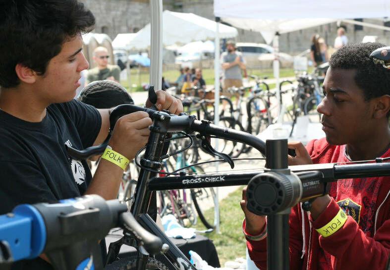Local kids working on bikes at Newport Folk Fest