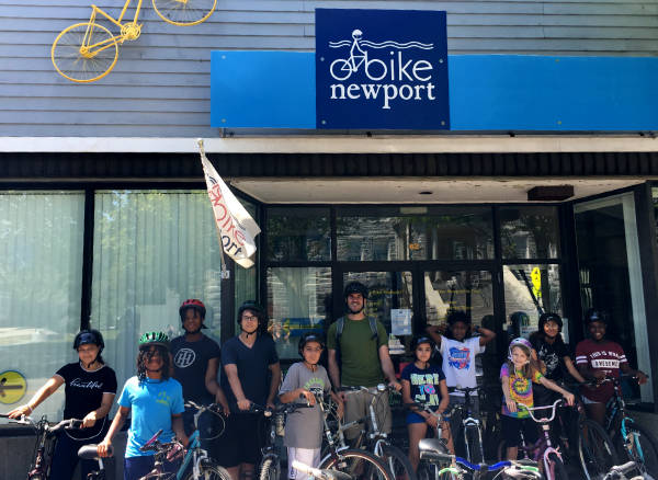 Group of happy bikers in front of our Offices at 62 Broadway in Newport, RI