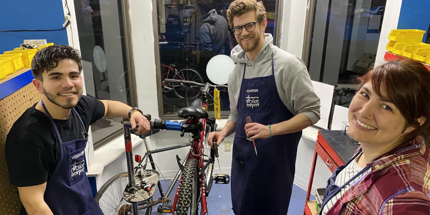 Three Bike Garage mechanics smiling in the shop
